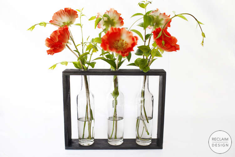 Bottle vases with sustainable reclaimed wood stand | Reclaim Design