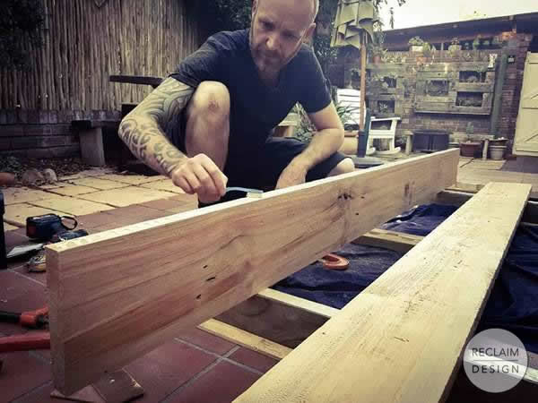 Gluing up the prepared roofing trusses as the table top | Reclaim Design