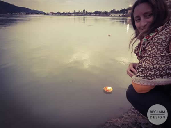 Nikki making offerings to the Ganges River Rishikesh India | Reclaim Design