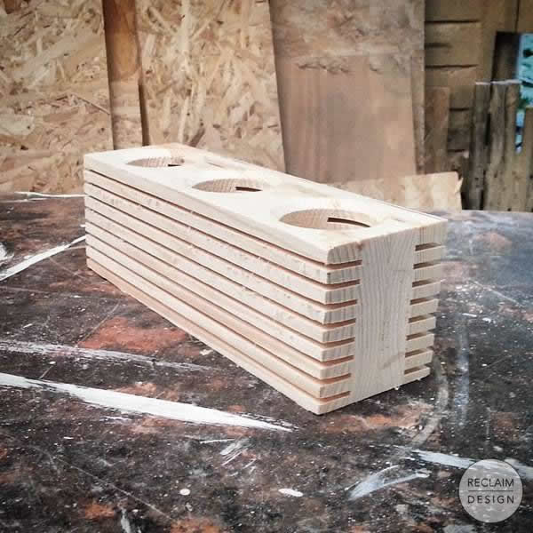 Reclaimed wood candle display in the workshop | Reclaim Design