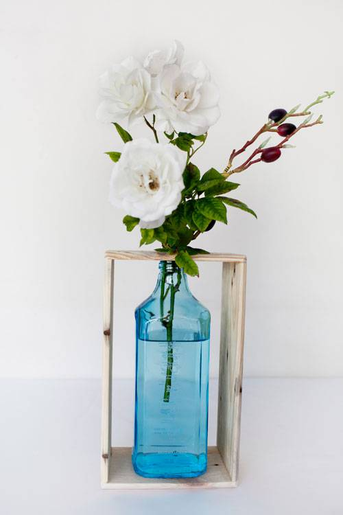 Recycled gin bottle flower vase with wooden stand | Reclaim Design