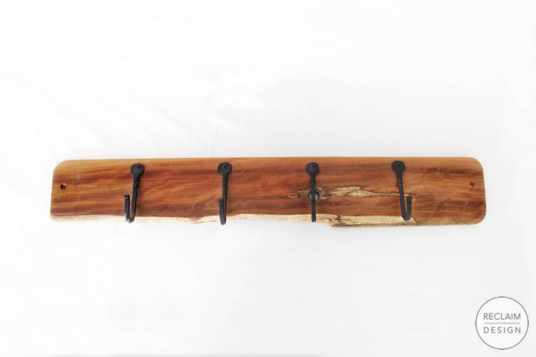 Sustainable coat rack made with reclaimed wood with cast iron hooks | Reclaim Design